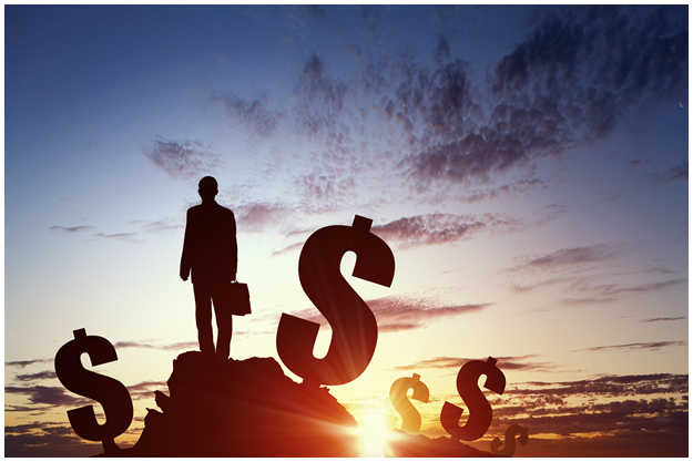 Man On Top of a Hill with Dollar Signs